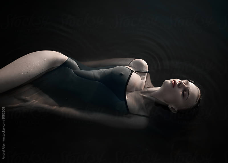 beautiful young girl model floats in water by Andrei Aleshyn for Stocksy United