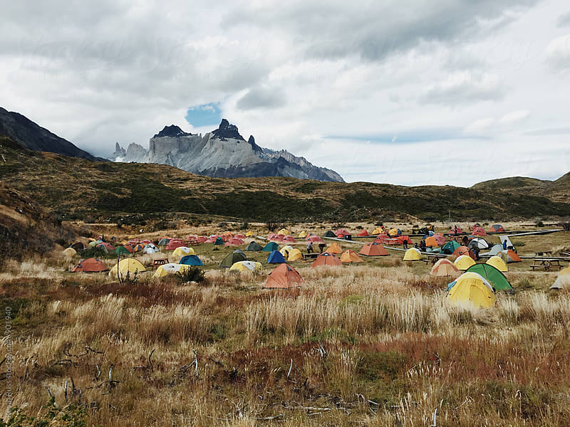 Rainbow Sea of Camping Tents in Meadow by Kevin Russ for Stocksy United