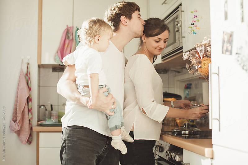 Young family in the kitchen by Irina Efremova for Stocksy United