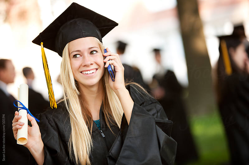 Graduation: Girl on Phone with Relative on Graduation Day by Sean Locke for Stocksy United