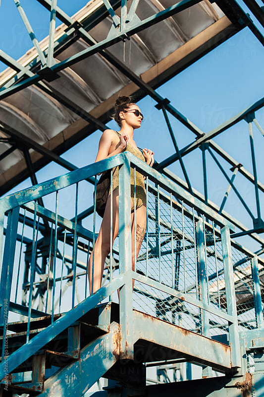 Fashionable female in tricot on platform  by Marko Milanovic for Stocksy United