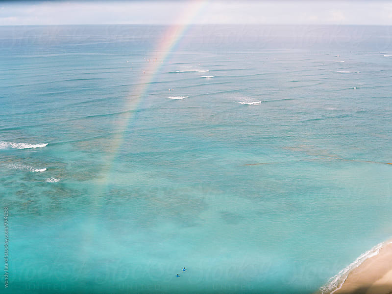 rainbow into waikiki ocean  by wendy laurel for Stocksy United