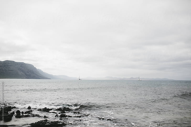 ocean view with sailboats in the  by Nicole Mason for Stocksy United