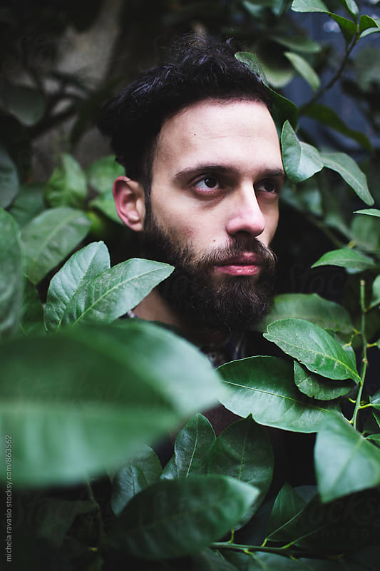 Portrait of man standing in the leaves by michela ravasio for Stocksy United