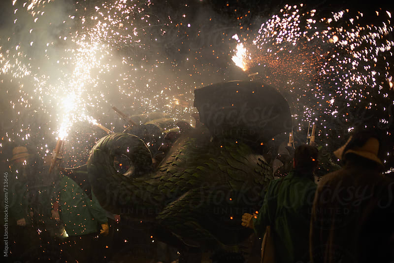 Dragon and chaos in a popular fire parade by Miquel Llonch for Stocksy United