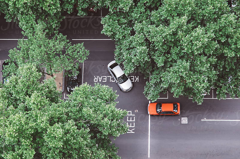 Looking down on cars from high above by Rowena Naylor for Stocksy United