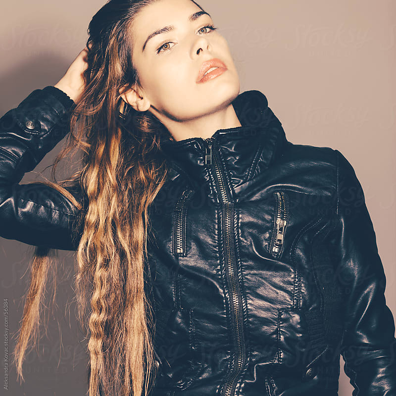 Young woman in leather jacket by Aleksandra Kovac for Stocksy United