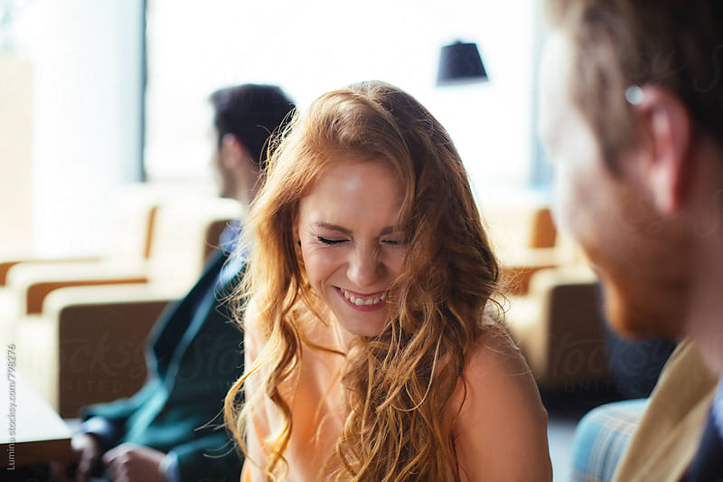 Ginger Woman Laughing in a Bar by Lumina for Stocksy United