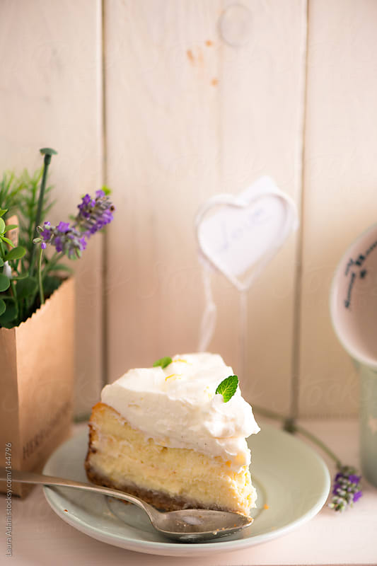 a slice of lemon cheesecake by Laura Adani for Stocksy United