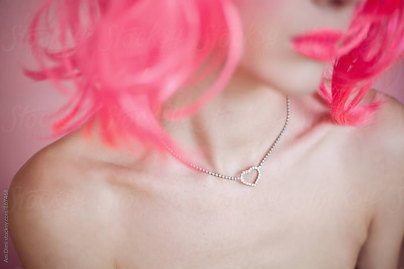Jewelry detail on woman with pink hair by Ani Dimi for Stocksy United