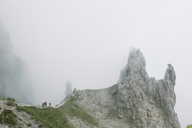 A group of mountaineers walking to the top of the mountain by michela ravasio for Stocksy United
