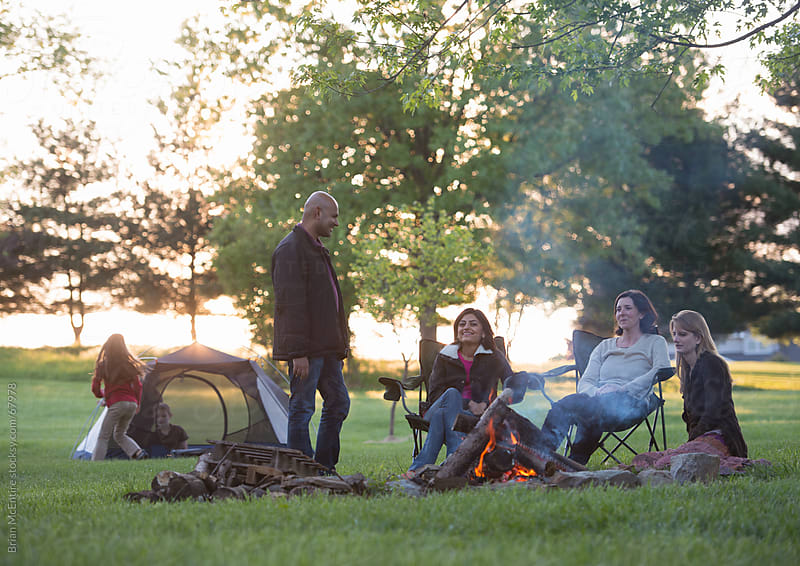 Backyard Camping: Parents, Friends, and Children Outdoors on Sum by Brian McEntire for Stocksy United