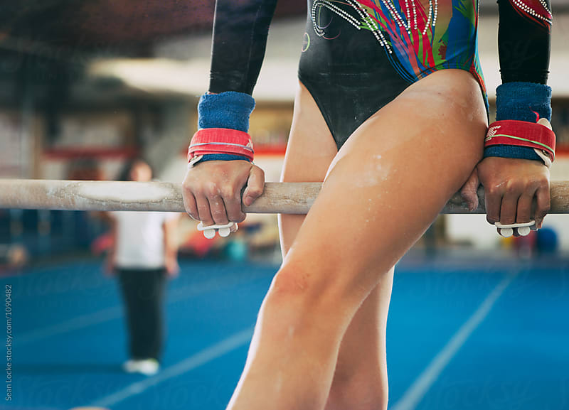 Gymnastics: Girl Practicing On Uneven Bars by Sean Locke for Stocksy United