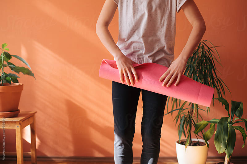 Woman holding a fitness mat by Marija Mandic for Stocksy United