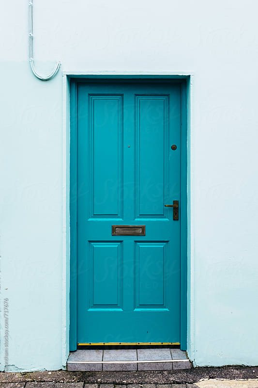 Bright blue door by Jen Grantham for Stocksy United