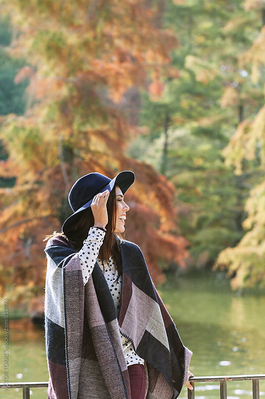 Attractive Woman in Autumn Scenery by Victor Torres for Stocksy United