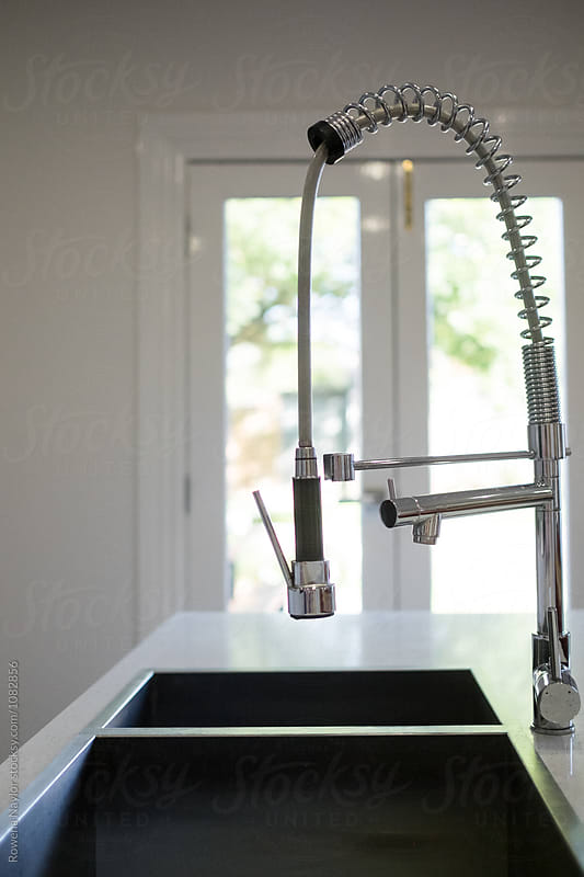Modern chef's kitchen faucet by Rowena Naylor for Stocksy United