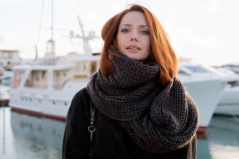 Portrait o redhead woman looking at camera by Lyuba Burakova for Stocksy United