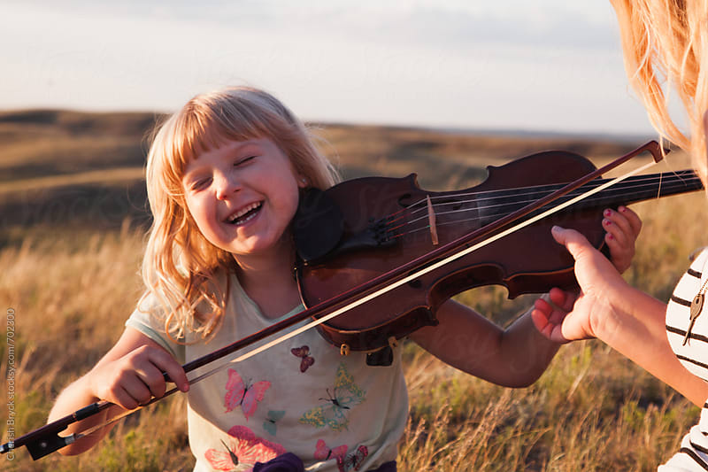 Play me a song on the fiddle. by Cherish Bryck for Stocksy United