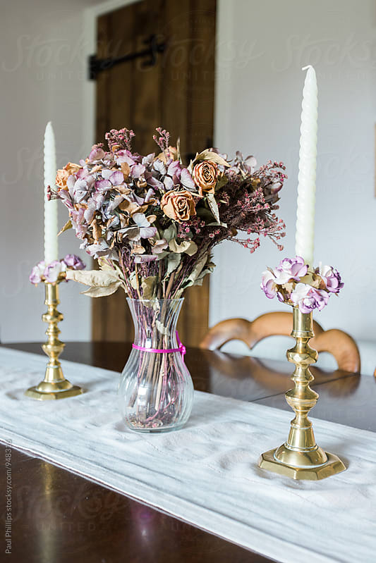 Dried flower display on a antique table setting. by Paul Phillips for Stocksy United