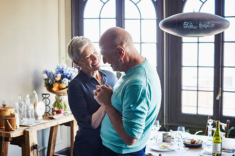 Senior Couple Dancing At Home by ALTO IMAGES for Stocksy United