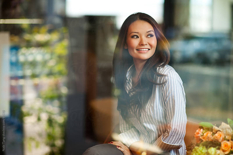 Beautiful smiling Asian business woman in the cafe by Nabi Tang for Stocksy United