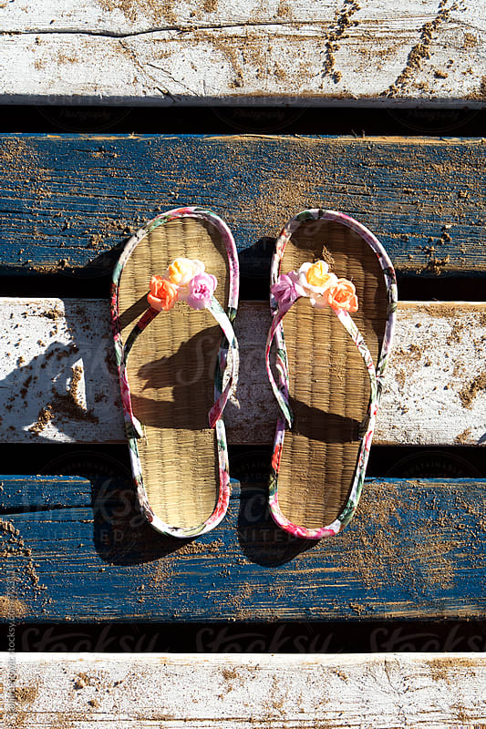summer footwear with flowers outdoor by Sonja Lekovic for Stocksy United