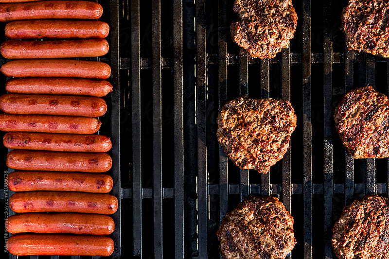 Hamburgers and Hot Dogs on the grill by Adam Nixon for Stocksy United