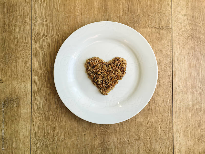 Heart-shaped quinoa and brown rice. by BONNINSTUDIO for Stocksy United