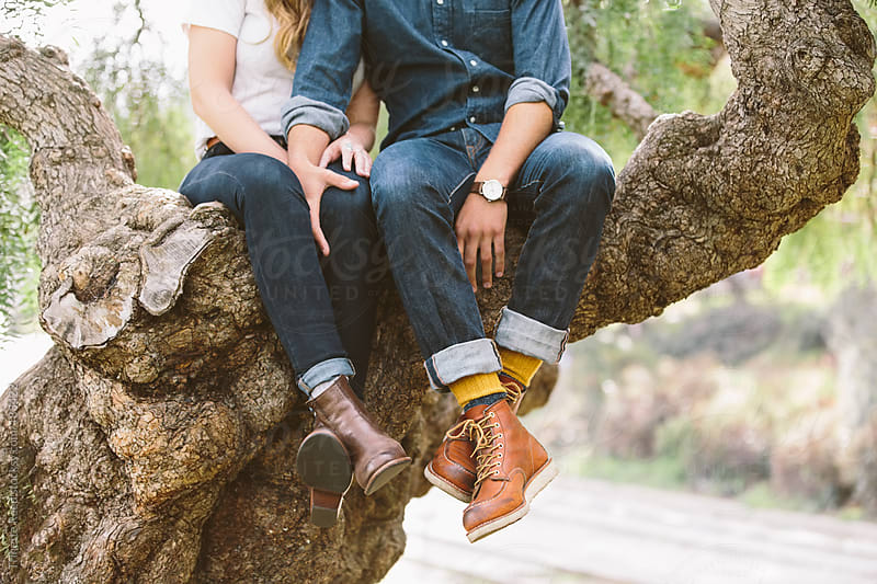 Couple relaxing in a tree by Trinette Reed for Stocksy United