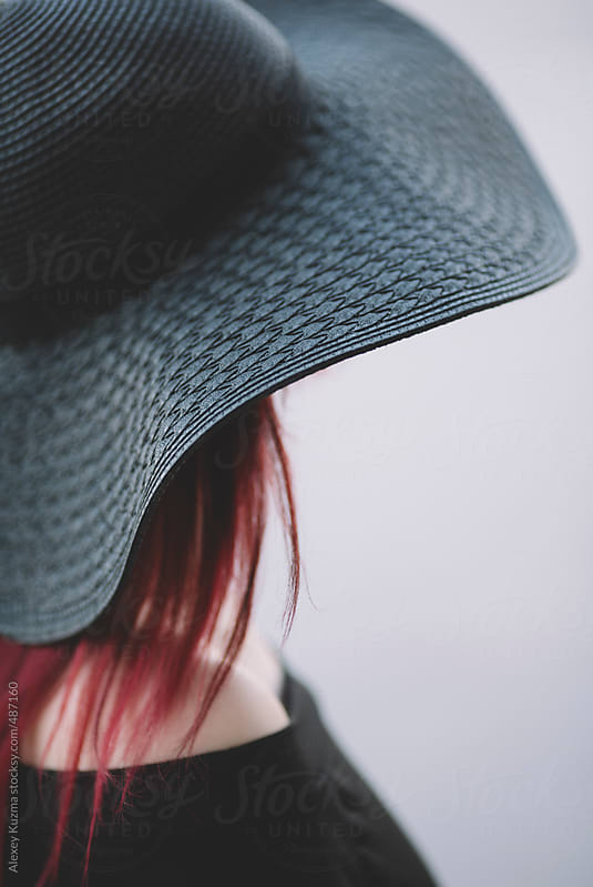 woman with black hat by Alexey Kuzma for Stocksy United