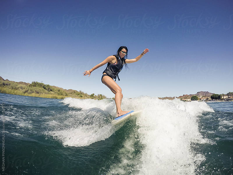 Woman Wakesurfing with Sunglasses by MEGHAN PINSONNEAULT for Stocksy United