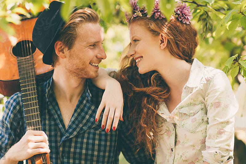 Couple in Love in an Orchard by Lumina for Stocksy United