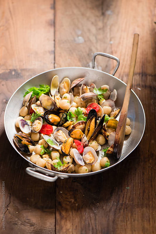 Gnocchi with mussels and clams by Laura Adani for Stocksy United