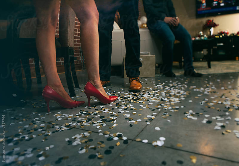 NYE: Friends Standing Around At End Of Party by Sean Locke for Stocksy United