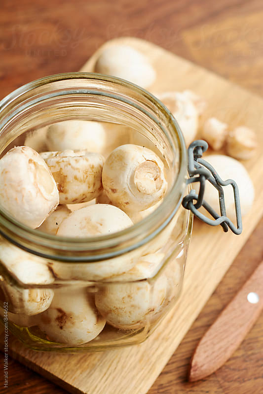 Making marinated mushrooms by Harald Walker for Stocksy United