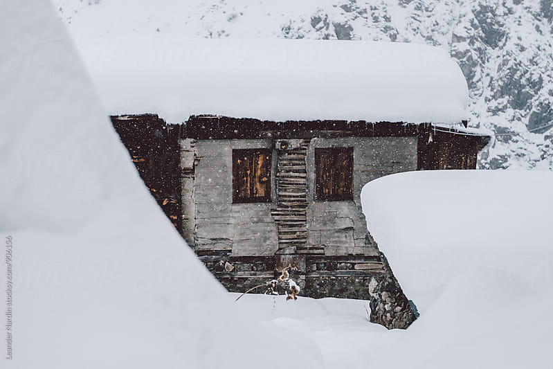 rural stone houses covered in snow in a small mountain village, east anatolia, turkey by Leander Nardin for Stocksy United