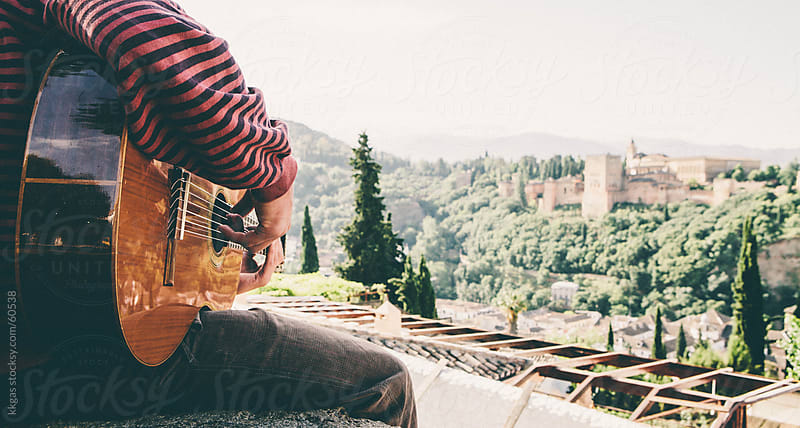 Guitarist overlooking the Alhambra in Granada. by kkgas for Stocksy United