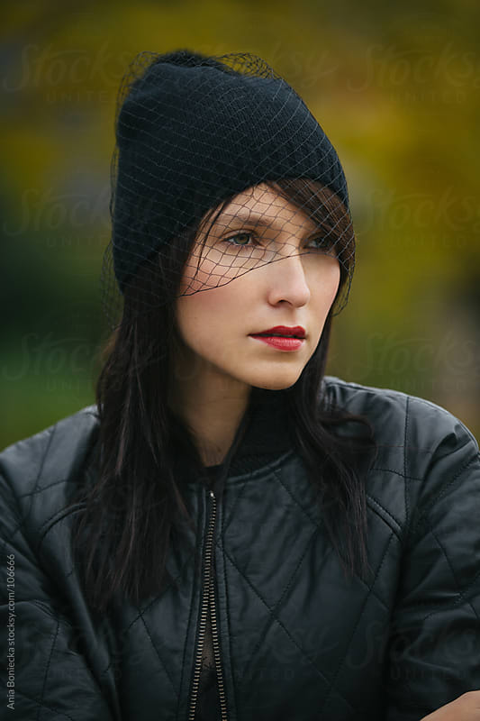 A portrait of a woman in  black netted beanie by Ania Boniecka for Stocksy United