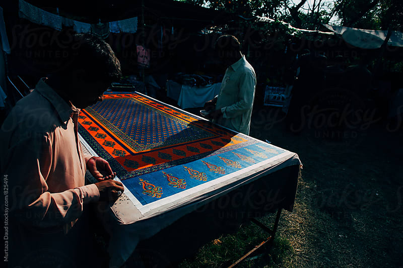 Pakistani craftsmen at work on a sunny day by Murtaza Daud for Stocksy United
