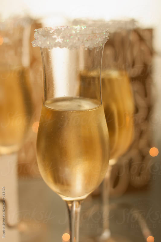 Glasses of Champagne for celebration by Beatrix Boros for Stocksy United