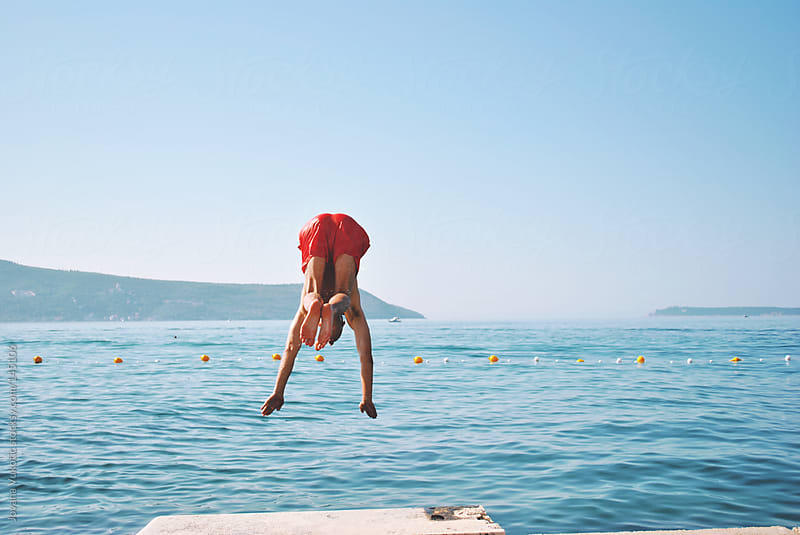 young man jumping by Jovana Vukotic for Stocksy United
