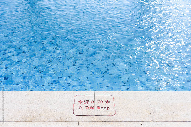 Blue and clean swimming pool edge by Lawren Lu for Stocksy United