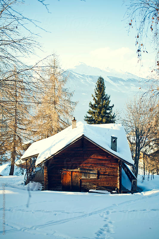 Wooden cabin in the snow in the mountains  by Denni Van Huis for Stocksy United