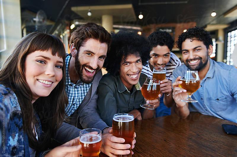 selfie friends in pub by Daxiao Productions for Stocksy United
