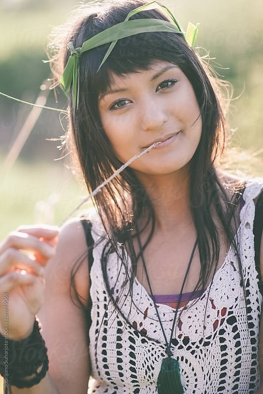 Portrait of a smiling beautiful woman looking up outdoor by Suprijono Suharjoto for Stocksy United