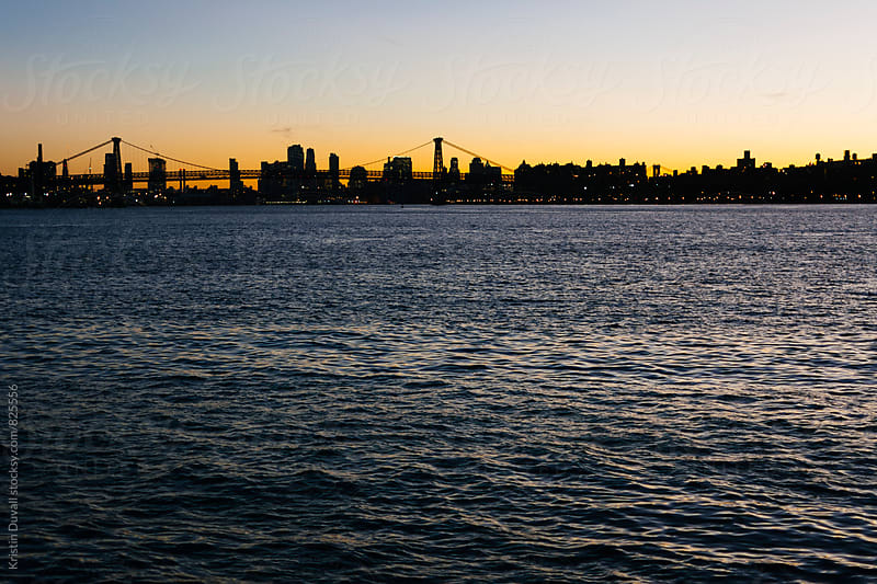 Williamsburg Bridge and Manhattan skyline at sunset. New York City. by Kristin Duvall for Stocksy United