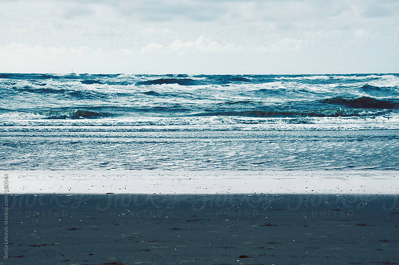 ocean, beach and sky by Sonja Lekovic for Stocksy United