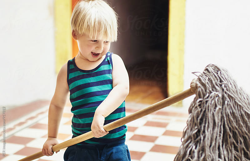 Cute boy is helping to clean and mop the house by Per Swantesson for Stocksy United