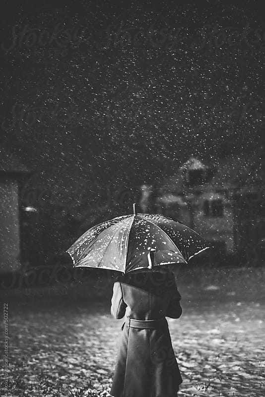 young girl with umbrella outdoors In snowfall by Koki Jovanovic for Stocksy United
